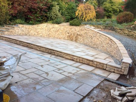 Dry stone wall and patio